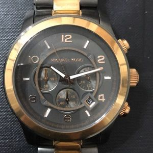 Authentic Michael Kors large faced watch.